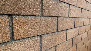 Каменная плитка для облицовки дома